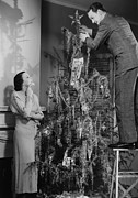 30-39 Years Framed Prints - Woman Assisting Man Placing Star On Top Of Christmas Tree, (b&w) Framed Print by George Marks