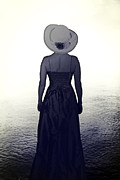 Straw Hat Posters - Woman At The Shore Poster by Joana Kruse