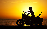 Enjoying Posters - Woman biker over sunset  Poster by Anna Omelchenko