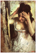 Victorian Era Woman Framed Prints - Woman Combing her Hair Before a Mirror Framed Print by Edgar Degas