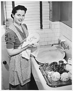 30-39 Years Framed Prints - Woman Drying Dishes At Kitchen Sink, (b&w), Elevated View Framed Print by George Marks