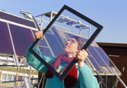 Glazing Framed Prints - Woman Holding An Interpane Thermotrope Window Framed Print by Volker Steger