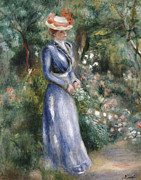 Standing Painting Framed Prints - Woman in a Blue Dress Standing in the Garden at Saint-Cloud Framed Print by Pierre Auguste Renoir