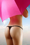 Sunbathe Prints - Woman in Bikini with a Pink Umbrella Print by Oleksiy Maksymenko