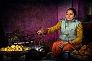 Yellow Sweater Posters - Woman in colorful dress cooking in streeet shop in Kathmandu Nep Poster by Max Drukpa