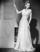 Evening Gown Photos - Woman In Evening Dress Posing Next To Door by George Marks