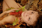 Yearning Prints - Woman in fallen leaves Print by Oleksiy Maksymenko