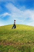 Grassy Field Posters - Woman in Gown Walking on Grassy Hill Poster by Jill Battaglia