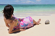 Legs Crossed Posters - Woman in pareo lying on tropical beach Poster by Sami Sarkis