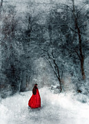 Period Clothing Posters - Woman in Red Cape Walking in Snowy Woods Poster by Jill Battaglia