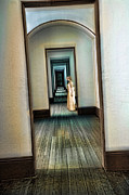 Wood Floors Prints - Woman in Vintage Gown in Hall of Doorways Print by Jill Battaglia