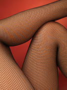 Body Parts Posters - Woman Legs in Fishnet Stockings Poster by Oleksiy Maksymenko