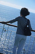 Mature Women Posters - Woman looking out to sea from deck of boat Poster by Sami Sarkis