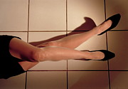 Flooring Prints - Woman lying on floor Print by Sami Sarkis