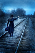 Anxious Framed Prints - Woman on Tracks Night Framed Print by Jill Battaglia