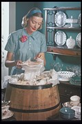 Home Ownership Posters - Woman Packs, Unpacks A Barrel With Dishes Poster by Archive Holdings Inc.