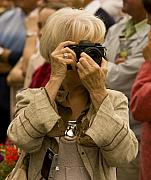 Village Fete Posters - Woman Photographer Capturing a Street Scene Poster by Mark Hendrickson