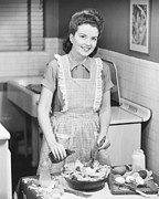 Dining Table Posters - Woman Preparing Salad In Kitchen , (b&w) Poster by George Marks