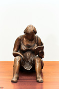 Reading Sculpture Posters - Woman reading a book bronze sculpture dress legs hands pages hair shoulders Poster by Rachel Hershkovitz