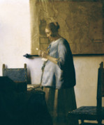 Letter Painting Posters - Woman Reading a Letter Poster by Jan Vermeer