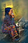 Magenta Dress Posters - Woman rocks stones smoke Kathmandu Nepal Poster by Max Drukpa