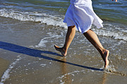 Enjoyment Photos - Woman running in water on beach by Sami Sarkis