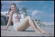 1940-1949 Prints - Woman Seated On Beach In Pink Bikini, 1940 Print by Archive Holdings Inc.