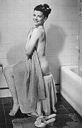 Domestic Bathroom Framed Prints - Woman Sitting In Bathroom, Covering Herself With Towel, (b&w), Portrait Framed Print by George Marks