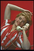 18-19 Years Prints - Woman Speaking On Phone, Circa, 1953 Print by Archive Holdings Inc.