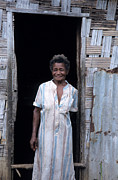 Pentecost Photos - Woman standing-up outside her home by Sami Sarkis