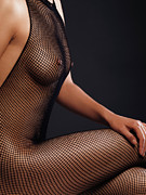 Legs Crossed Posters - Woman Wearing Fishnet Bodystocking Poster by Oleksiy Maksymenko