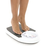 Body Conscious Posters - Woman Weighing Herself Poster by