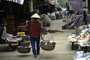 Baskets Photos - Woman With Bamboo Hat Carries Balanced by Raymond Gehman