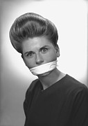 Hair Bun Metal Prints - Woman With Covered Mouth In Studio, (b&w), Portrait Metal Print by George Marks