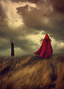 Daydream Posters - Woman with red cape walking in sand dunes   Poster by Sandra Cunningham