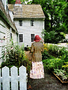 Woman With Striped Jacket And Flowered Skirt Print by Susan Savad