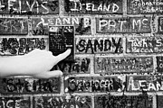Elvis Photos - Womans Hand Pushing Old Intercom Button On Wall Covered In Graffiti Outside Graceland Memphis by Joe Fox