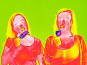 Creams Prints - Women Eating Ice Lollies, Thermogram Print by Tony Mcconnell