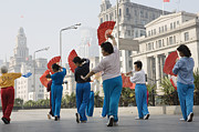 Bund Shanghai Prints - Women Practising Tai Chi With Fans On The Bund Print by John Banagan