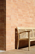 Patterned Posters - Wooden Bench Against Corner of Brick Building Poster by Jeremy Woodhouse
