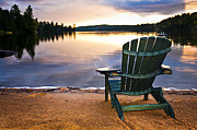 Adirondack Photos - Wooden chair at sunset on beach by Elena Elisseeva