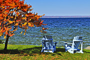 Fall Grass Posters - Wooden chairs on autumn lake Poster by Elena Elisseeva