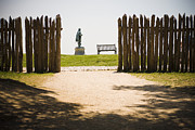 Fort Smith Posters - Wooden Fence And Statue Of John Smith Poster by Roberto Westbrook