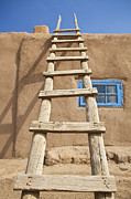 Pueblo De Taos Acrylic Prints - Wooden Ladder Against an Adobe Building Acrylic Print by Bryan Mullennix