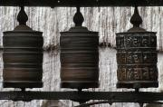 Kathmandu Posters - Wooden Prayer Wheels Poster by Sean White