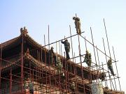 Workers Climb Scaffolding On The Palace Print by Justin Guariglia