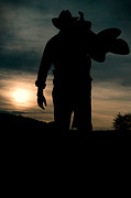 Closing Time Prints - Working man silhouette at sunset - Cowboy calling it a day Print by Andre Babiak