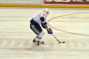 Skates Photos - Working the Puck by Karol  Livote