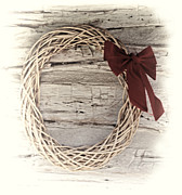 Cabin Wall Photo Framed Prints - Woven Reed Wreath Framed Print by Linda Phelps