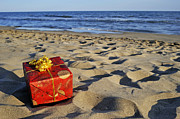 Out Of Context Posters - Wrapped gift box on beach Poster by Sami Sarkis